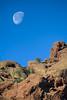 The full moon setting over Camelback Mountain