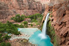 Havasu Falls with a 100 foot drop into a blue pool.  The blue color is from lime - which also cakes the falls and creates the travertine rock formations on the fall's cliff.